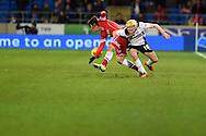 Ben Pringle of Rotherham Utd (18) tackles Cardiff city's Kim Bo-Kyung. .Skybet football league championship match, Cardiff city v Rotherham Utd at the Cardiff city stadium in Cardiff, South Wales on Saturday 6th December 2014<br /> pic by Andrew Orchard, Andrew Orchard sports photography.