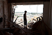 Sco0033837 .  Daily Telegraph..Inspecting the damage done to their home during the battle for the Bab al Azizia compound. The vast majority of the city is now in the full control of the rebels...Tripoli 29 August 2011. ............Not Getty.Not Reuters.Not AP.Not Reuters.Not PA