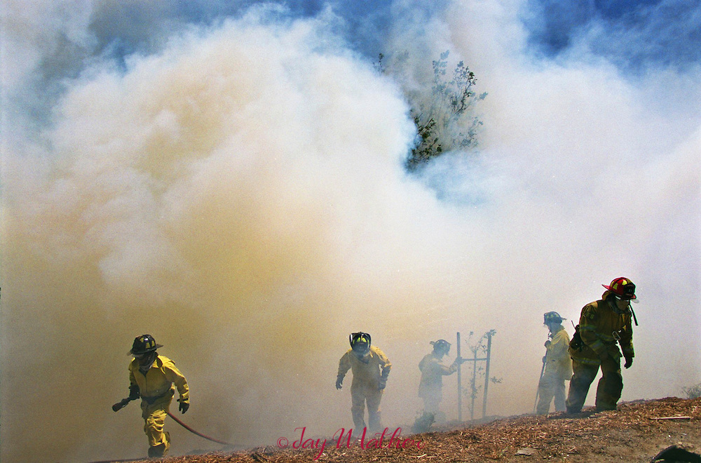 Firefighters contain a blaze along I-5 in Sacramento, CA