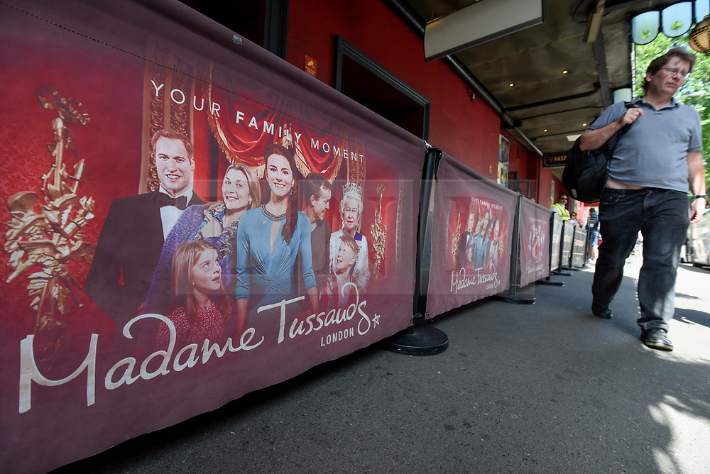 © Licensed to London News Pictures. 28/06/2019. LONDON, UK.  External signage featuring images of waxworks of the Royal Family outside Madame Tussauds near Baker Street.  Danish company Kirkbi Invest, which controls the Lego toy firm, has agreed to pay £4.8bn for Merlin Entertainments.  Merlin owns the Madame Tussauds as well as the London Eye, Alton Towers, Chessington Adventures as well as other UK attractions.  Photo credit: Stephen Chung/LNP