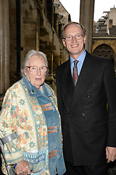 """Royal, Religious and National Events Commentator for Sky News ALASTAIR BRUCE and his mother MRS HENRY BRUCE at a private view to view """"The Coronation Theatre: Portrait of Her Majesty Queen Elizabeth II"""" painted by Ralph Heimans held at Westminster Abbey, London on 12th September 2013."""