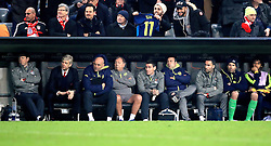 Arsenal manager Arsene Wenger (second left), assistant manager Steve Bould (third left), club doctor Gary O'Driscoll (centre, Arsenal's Mohamed Elneny (right) and Arsenal goalkeeper Petr Cech (second right) in the dugout