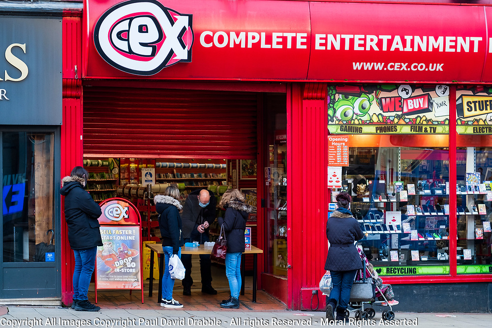 In an attempt to help reduce the spread of Corona Virus CEX in Sheffield serves customers at the door during the 2020/2021 COVID 19 pandemic<br /> <br /> 05 January 2020<br /> <br /> www.pauldaviddrabble.co.uk<br /> All Images Copyright Paul David Drabble - <br /> All rights Reserved - <br /> Moral Rights Asserted -