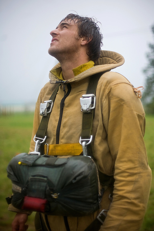 A rookie smokejumper stands for a portrait at the McCall smokejumper base in McCall, ID.