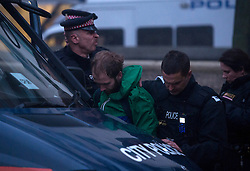 © Licensed to London News Pictures. 01/11/2015. London, UK. A man being detained by police at The scene where Riot police clashed with party goers at the site of an illegal halloween rave in London where it has been reported that a petrol bomb was thrown. Photo credit: Ben Cawthra/LNP
