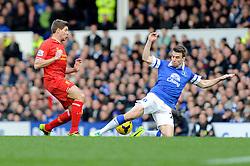 Everton's Phil Jagielka tackles Liverpool's Steven Gerrard - Photo mandatory by-line: Dougie Allward/JMP - Tel: Mobile: 07966 386802 23/11/2013 - SPORT - Football - Liverpool - Merseyside derby - Goodison Park - Everton v Liverpool - Barclays Premier League
