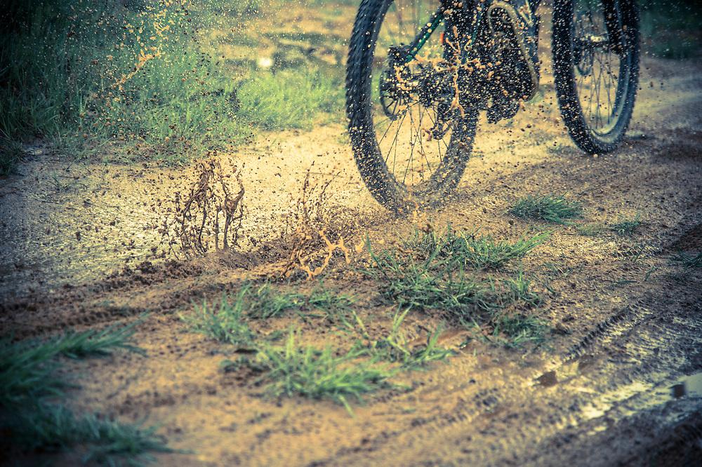 Downhill mountain bikers ride ride a muddy course at Marquette Mountain Ski Area in Marquette, Michigan.