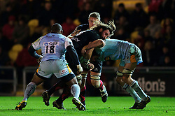Dragons replacement (#19) Ian Nimmo is tackled during the second half of the match - Photo mandatory by-line: Rogan Thomson/JMP - Tel: Mobile: 07966 386802 18/11/2012 - SPORT - RUGBY - Rodney Parade - Newport. Newport Gwent Dragons v Northampton Saints - LV= Cup Round 2