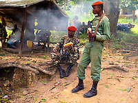 Members of a Guinean special forces unit take a lunch break<br /> while on patrol at the Guinean border with Ivory Coast, December 15,<br /> 2010. Nearly 4,000 refugees fro Ivory Coast have fled into neighboring<br /> Guinea and Liberia in the past two weeks, and Guinea has stepped up<br /> its security at the borders.