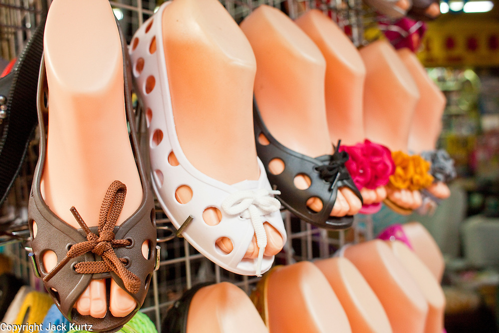 07 OCTOBER 2009 -- BANGKOK, THAILAND: Women's shoes for sale in Chinatown in Bangkok, Thailand. Chinatown is the old commercial heart of Bangkok with thousands of small shops selling everything from clothes to dried fish to case lots of shoes and gem stones.   Photo By Jack Kurtz