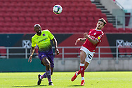 Exeter City's Nigel Atangana (4) and Bristol City's Jamie Paterson (10) during the EFL Cup match between Bristol City and Exeter City at Ashton Gate, Bristol, England on 5 September 2020.