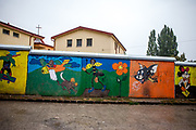 View to the pastoral centre of the Salesians of Don Bosco mission, surrounded by a wall - at Lunik IX in Kosice. The LUNIK IX housing complex - populated with almost 100% Roma inhabitans - in the western-central part of the city of Kosice located in Eastern Slovakia. The living conditions in Lunik IX are partly very bad and many people do not have electricity, water or gas. Some of the buildings are completely devasted.