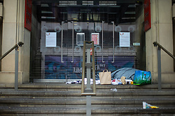 © Licensed to London News Pictures. 25/12/2020. Manchester, UK. A homeless person is seen sleeping rough in the door to the Royal Exchange Theatre on Cross Street in Manchester City Centre on the morning of Christmas Day . Photo credit: Joel Goodman/LNP