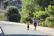 Girl Running on a Path with her Dog