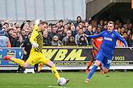 AFC Wimbledon Forward Joe Pigott (39) chases down Wycombe Wanderers Goalkeeper Ryan Allsop (1) during the EFL Sky Bet League 1 match between AFC Wimbledon and Wycombe Wanderers at the Cherry Red Records Stadium, Kingston, England on 27 April 2019.