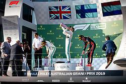 March 17, 2019 - Albert Park, VIC, U.S. - ALBERT PARK, VIC - MARCH 17: L-R Second place Mercedes-AMG Petronas Motorsport driver Lewis Hamilton (44), winner Mercedes-AMG Petronas Motorsport driver Valtteri Bottas (77) and Aston Martin Red Bull Racing driver Max Verstappen (33) on the podium at The Australian Formula One Grand Prix on March 17, 2019, at The Melbourne Grand Prix Circuit in Albert Park, Australia. (Photo by Speed Media/Icon Sportswire) (Credit Image: © Steven Markham/Icon SMI via ZUMA Press)