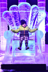© Licensed to London News Pictures. 16/11/2017. London, UK. Jack Dury aged 3 sits on the throne of a large ice sculpture on display as part of the Deep Sea Adventure. The Magical Ice Kingdom is the largest indoor ice and snow sculpture experience in Europe and part of the Hyde Park Winter Wonderland. Photo credit: Ray Tang/LNP