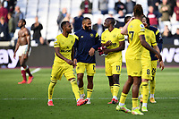 Football - 2021 / 2022  Premier League - West Ham United vs Brentford - The London Stadium - Sunday 3rd October 2021<br /> <br /> Bryan Mbeumo of Brentford (blue top) with Rico Henry (left) and Yoane Wissa at the final whistle.<br /> <br /> COLORSPORT/Ashley Western