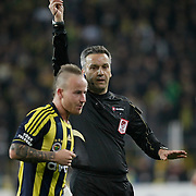Referee's Mustafa Kamil Abitoglu show the yellow card to Fenerbahce's Mirosloav Stoch during their Turkish superleague soccer match Fenerbahce between Gaziantepspor at the Sukru Saracaoglu stadium in Istanbul Turkey on Monday09 January 2011. Photo by TURKPIX