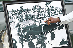 A framed photograph of Queen Elizabeth II driving a car when she visited Nigeria in the 1950s, outside the High Commissioner's Residence in Nigeria, on day seven of the The Prince of Wales and Duchess of Cornwall trip to west Africa.