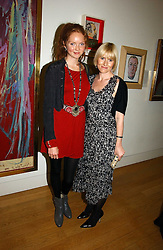 Left to right, Model LILY COLE and AMY ASTLEY Editor in Chief of Teen Vogueat the opening of an exhibition entitled Exceptional Youth supported by Teen Vogue at the National Portrait Gallery, London on 3rd November 2006.<br /><br />NON EXCLUSIVE - WORLD RIGHTS