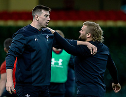 Adam Beard of Wales with team-mate  Tomas Francis<br /> <br /> Photographer Simon King/Replay Images<br /> <br /> Six Nations Round 5 - Wales v Ireland Captains Run - Saturday 15th March 2019 - Principality Stadium - Cardiff<br /> <br /> World Copyright © Replay Images . All rights reserved. info@replayimages.co.uk - http://replayimages.co.uk