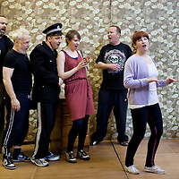 """Picture shows : Greg Hemphill as Finlay, Jimmy Chisolm as Simon  Johnny McKnight as Callum,  Sally Reid as Marie, Paul Riley as Fran and  Ros Sydney as Morag..Rehearsal of the forthcoming National Theatre of Scotland production 'An Appointment with The Wicker Man'..Picture © Drew Farrell  ( Tel : 07721-735041 ).On a remote Scottish island, the Loch Parry Theatre Players mount their am-dram version of The Wicker Man. When their lead actor goes missing in mysterious circumstances, they call on the services of a television cop from the mainland to step in and save their production. ..The play opens at the MacRobert Arts Centre, Stirling on 18th February 2012 before touring Aberdeen, Glasgow, Inverness and Dunfermline...The Wicker Man regularly tops """"Best Horror Film of All Time"""" lists and is regarded as a true film classic. With an unforgettable sense of creeping dread, a wonderfully memorable score by Paul Giovanni, career defining performances from Edward Woodward and Christopher Lee it also has arguably the best ending in cinema history. Now, in an affectionate new adaptation, the National Theatre of Scotland gives a gallus round of applause to this immortal chronicle of strange goings-on in a wee village. ..An Appointment with the Wicker Man features Greg Hemphill (Chewin' the Fat) and Johnny McKnight (Little Johnny's Big Gay Wedding) alongside a line-up of comic talent. It is at once a deliciously wicked homage to, and a tender celebration of, a piece of cinema history that reveals for us the spooky undercurrents lurking just below the surface of Scottish village life. ..The Loch Parry Players are messing with forces they can't possibly comprehend but at the end of the night, only one thing is for sure . . . someone's going to burn for this...Cast..Sean Biggerstaff    as       Howie and Rory.Jimmy Chisolm      as       Simon.Greg Hemphill        as     Finlay.Johnny McKnight   as      Callum.Sally Reid                 as      Marie.Paul Riley"""