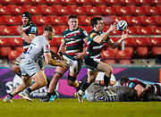 Leicester Tigers centre Matt Scott collects the ball as Sale Sharks centre Sam Hill gives pursuit during a Gallagher Premiership Round 7 Rugby Union match, Friday, Jan. 29, 2021, in Leicester, United Kingdom. (Steve Flynn/Image of Sport)