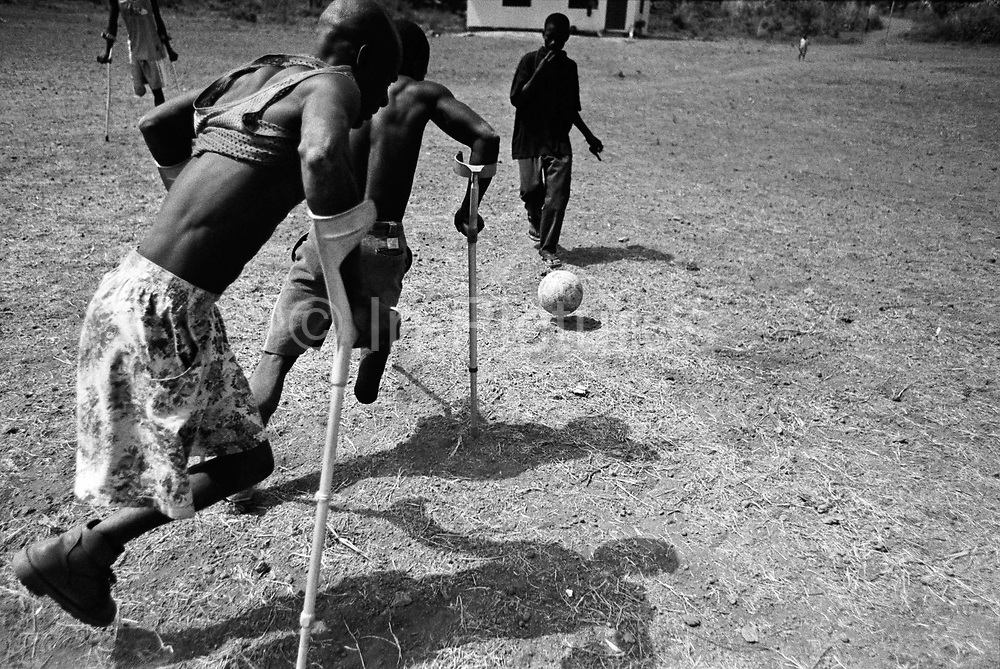 Members of an Amputee Football Team practice their game in Makeni at a resettlement camp for war wounded and amputees. Sierra Leone 2004<br /> Rebel forces, the Revolutionary United Front in Sierra Leone, systematically murdered, mutilated, and raped civilians during the country's civil war as a policy of terror