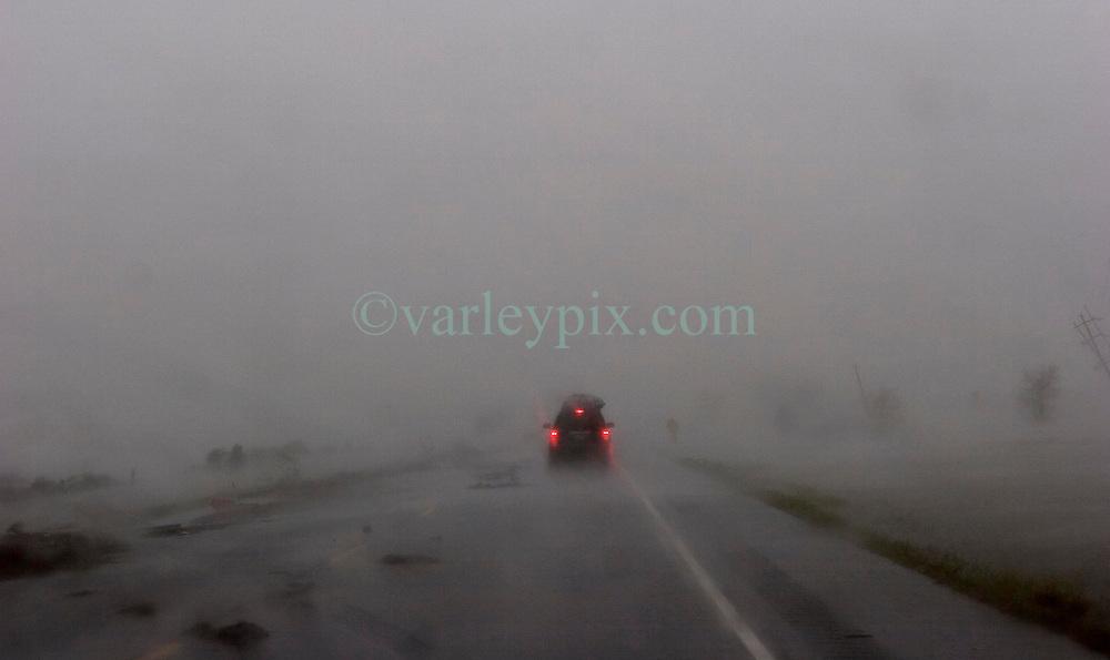 24th Sept, 2005. Hurricane Rita, rte 27, Louisiana where the storm hit hardest on the Louisiana/Texas border. The back edge of Rita floods across the roadway.