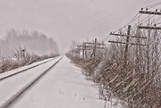 Close companions across the continent, rails and telegraph wires vanish into the snowy distance while flakes are driven across the wintery scene. This is a live track, the rails are clear of snow.