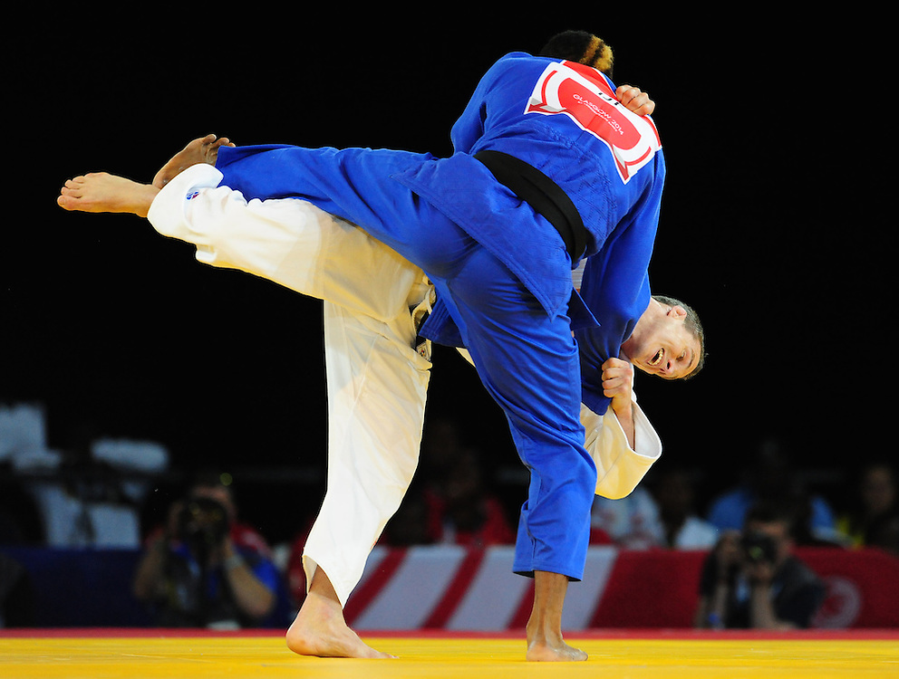 Scotland's Euan Burton (wearing white) during his victory in the men's -100kg preliminary round of 16 contest against Seychelles' Evans Ouko Kengara<br /> <br /> Photographer Chris Vaughan/CameraSport<br /> <br /> 20th Commonwealth Games - Day 3 - Saturday 26th July 2014 - Judo - SECC - Glasgow - UK<br /> <br /> © CameraSport - 43 Linden Ave. Countesthorpe. Leicester. England. LE8 5PG - Tel: +44 (0) 116 277 4147 - admin@camerasport.com - www.camerasport.com