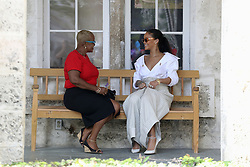Rihanna and councillor Ministry of Health HIV Program Susette Neblett-Straughn talk during the 'Man Aware' event held by the Barbados National HIV/AIDS Commission in Bridgetown, Barbados, during his tour of the Caribbean.