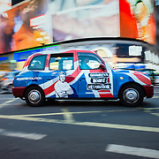 London black cab in Picadilly Circus at night
