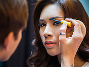 25 MARCH 2015 - BANGKOK, THAILAND: A contestant puts on her makeup before the first round of the Miss Tiffany's contest at CentralWorld, a large shopping mall in Bangkok. Miss Tiffany's Universe is a beauty contest for transgender contestants; all of the contestants were born biologically male. The final round will be held on May 8 in the beach resort of Pattaya. The final round is televised of the  Miss Tiffany's Universe contest is broadcast live on Thai television with an average of 15 million viewers.       PHOTO BY JACK KURTZ