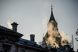 © Licensed to London News Pictures. 02/11/2017. London, UK. Steam bellows out from a building in front of the Houses of Parliament on a cold autumn morning on November 2, 2017. Parliament has been embroiled in a scandal following claims of sexual abuse by some of its members. Photo credit: London News Pictures