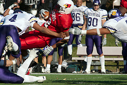 29 October 2005: Redbird Cortes Rice spins through the air to get a few extra yards as Leatherneck Chris McNutt makes the final grab. With a final score of 31 - 17, Western Illinois University Leathernecks collared the Illinois State University Redbirds knocking them from their 18th ranked perch at Hancock Field on Illinois State's campus in Normal IL