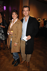 Artist TRACEY EMIN and SCOTT DOUGLAS at an auction in aid of The Parkinson's Appeal for Deep Brain Stimulation 'Meeting of Minds' held at Christie's, King Street, London SW1 followed by a dinner at St.John, 26 St.John Street, London on 16th October 2007.<br /><br />NON EXCLUSIVE - WORLD RIGHTS