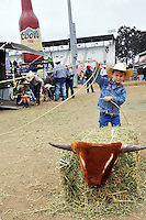 A young roper practices outside the Steer Gear trailer on Saturday at the 2013 California Rodeo Salinas.