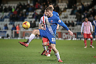 Luke James (Hartlepool United) controls the ball under pressure from the Stevenage defender during the Sky Bet League 2 match between Hartlepool United and Stevenage at Victoria Park, Hartlepool, England on 9 February 2016. Photo by Mark P Doherty.
