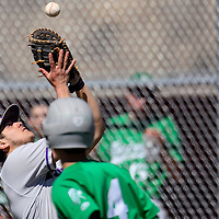 032115       Cable Hoover<br /> <br /> Miyamura Patriot Joey Guillen (17) gets his glove under a foul ball from the Moriarty Pintos Saturday at the Gallup Sports Complex.