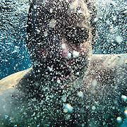 Underwater Portrait. #crete #greece #lybiansea #water #sea #portrait #bubbles #latergram #man #light #shadow