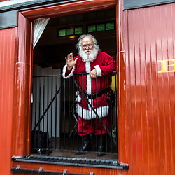 Strasburg, PA USA - December 20, 2014:  Santa arrives by steam locomotive in Strasburg, Lancaster County.