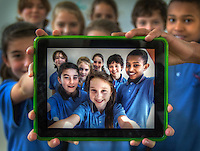 Ringwood North Primary School is  participating in the IPAD trial. Clockwise from Front, Charlotte, Cassie Kaylah, (Gemma in back left corner), Olivia, Zac and Grant. Pic By Craig Sillitoe CSZ/The Sunday Age.27/7/2011  Pic By Craig Sillitoe CSZ / The Sunday Age melbourne photographers, commercial photographers, industrial photographers, corporate photographer, architectural photographers, This photograph can be used for non commercial uses with attribution. Credit: Craig Sillitoe Photography / http://www.csillitoe.com<br /> <br /> It is protected under the Creative Commons Attribution-NonCommercial-ShareAlike 4.0 International License. To view a copy of this license, visit http://creativecommons.org/licenses/by-nc-sa/4.0/.