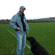 Portrait of Kevin Percival and his dog Billybob at Parson Cross park, Sheffield, South Yorkshire, UK