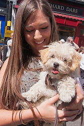"""Primrose Hill, London, May 18th 2014. Katie Shemesh and her """"Malitpoo"""" Smootie enjoy the warm sunshine at the Primrose Hill Fair dog show in London"""