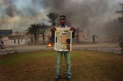 A Palestinian man hold a poster of Yasser Arafat, Gaza, Palestinian Territories, Nov. 11, 2004. Arafat died in a Paris hospital at the age of 75.