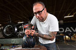 Skratch, the Pinstripe Artist, Fabricator and Hot Rod Builder of Skratch's Garage TV fame was set up in the Harley-Davidson garage at the Full Throttle Saloon during the Sturgis Black Hills Motorcycle Rally. SD, USA. Saturday, August 10, 2019. Photography ©2019 Michael Lichter.