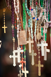 Collection of hanging plastic cross rosaries