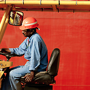 Scenes from a ship yard in Dubai. Worker driving a vehicle